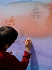 One of the cool things about the street fair are the activities, here passersby participate in making a Buddhist painting