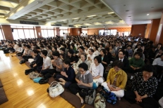 The other floors were filled with people who couldn't get into the main Dharma hall during the ceremony, which was projected onto large screens in the other floors.